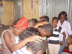 Girls praying for the 5 girls going to boarding school at the end of this month.